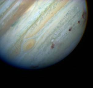 jupiter protects the earth from gettig hit by comets and asteroids